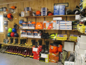 Hard hats, Rubber boots,  Logging clothes